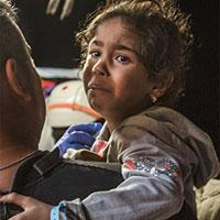 De vader van Amena (5) besluit met zijn gezin de gevaarlijke reis naar Italië te ondernemen. Een reis waarbij ze overgeleverd zijn aan meedogenloze smokkelaars en de Middellandse Zee. Ze wonen nu in in Nederland. <a href=
